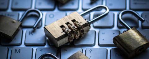 padlocks on a laptop keyboard